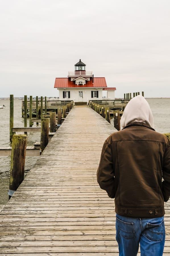 Walking to roanoke marshes. A man walking up to roanoke marshes lighthouse royalty free stock image