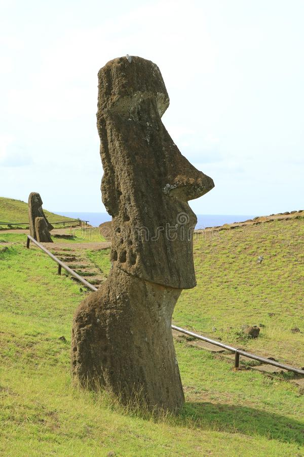 Walking trail for visitors on Rano Raraku volcano, the Moai statue quarry on Easter Island of Chile, UNESCO World Heritage. Archaeological Site stock photo