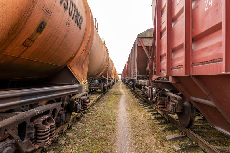 Walking between two cargo trains royalty free stock images