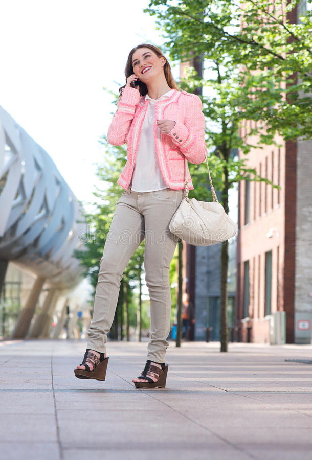 Walking Woman Talking On Mobile Phone In The City Royalty Free Stock Photography