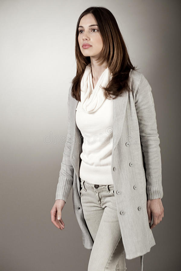 Download Walking Young Fashion Model With Her Spring Coat Royalty Free Stock Photos - Image: 12268578