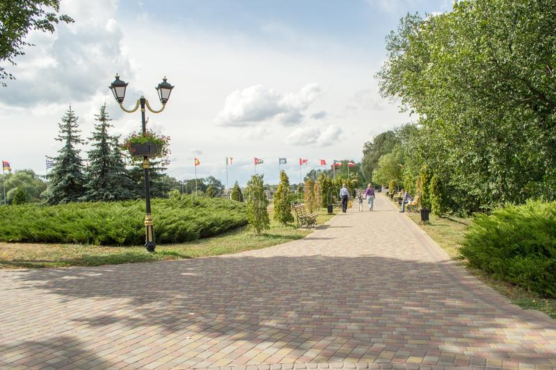 Beautiful walking avenue at the embankment in Myrgorod. At the territory of the resort. royalty free stock photo