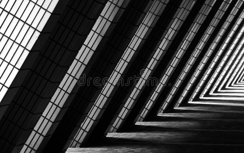 Walkway architecture with diagonal beams and shadow play. royalty free stock photo