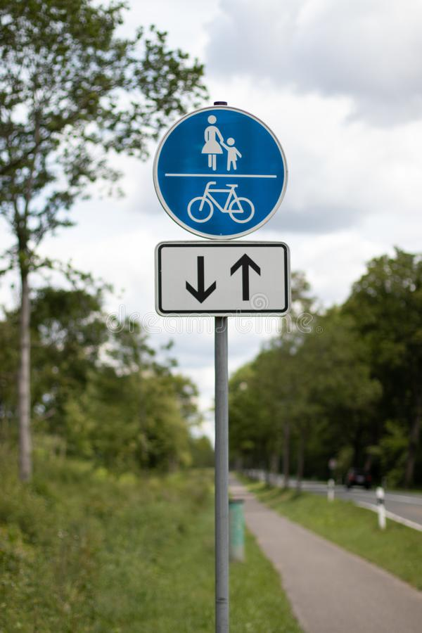 Walkway and bicycle way sign, arrow for both direction stock photo