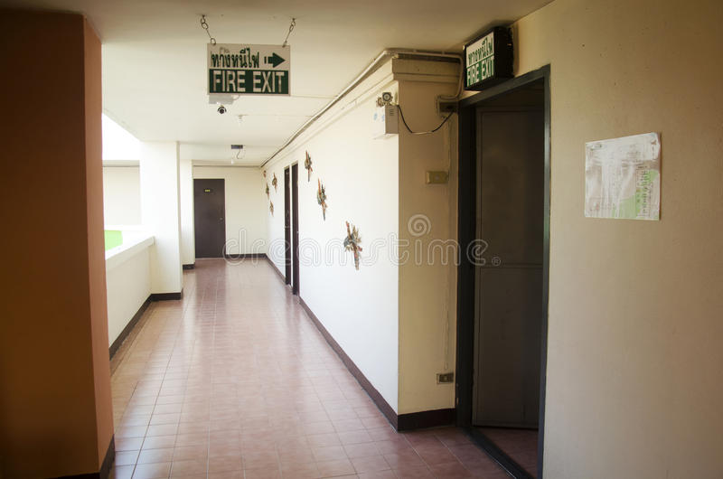 Walkway and fire exit inside of hotel in morning time. At Thailand stock image