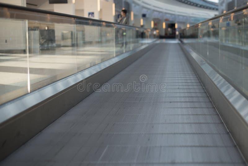 Walkway flat escalator in the airport stock photo