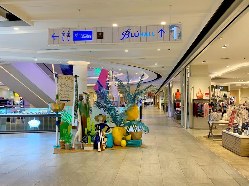 Walkway and its decoration with many shop window display at Blueport Hua Hin shopping mall Hua Hin, Thailand March 1, 2019. The walkway and its decoration with royalty free stock photos