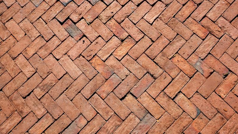 Walkway outside the building made of bricks.The exterior walkway pattern is decorated with red brick stock photos
