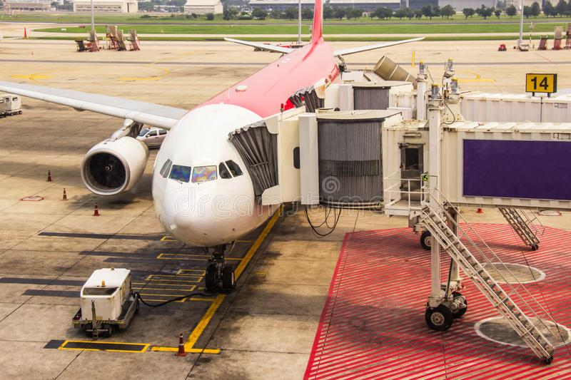 Walkway for passengers boarding plane parked at the Don Muang international airport is a major international Thailand stock photography