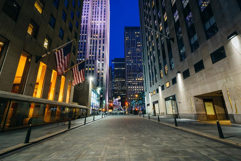 Walkway at Rockefeller Center at night, in Midtown Manhattan, New York.  royalty free stock image