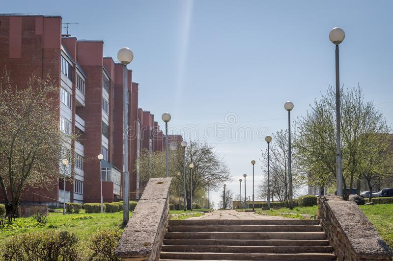 A walkway through soviet built apartment blocks in Sillamae in Estonia on a sunny day. A pedestrian street in a typical soviet constructed town stock photo