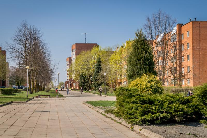 A walkway through soviet built apartment blocks in Sillamae in Estonia on a sunny day. A pedestrian street in a typical soviet constructed town with local royalty free stock image