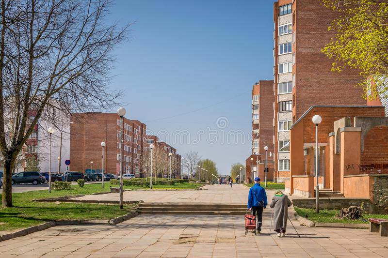 A walkway through soviet built apartment blocks in Sillamae in Estonia on a sunny day. A pedestrian street in a typical soviet constructed town royalty free stock image