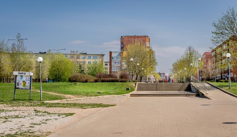 A walkway through soviet built apartment blocks in Sillamae in Estonia on a sunny day. A pedestrian street in a typical soviet constructed town with local stock photo