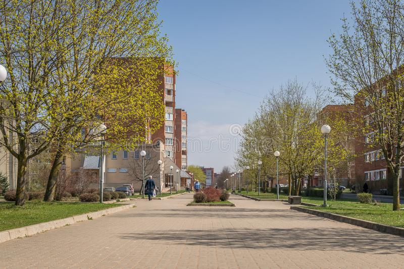 A walkway through soviet built apartment blocks in Sillamae in Estonia on a sunny day. A pedestrian street in a typical soviet constructed town royalty free stock photo