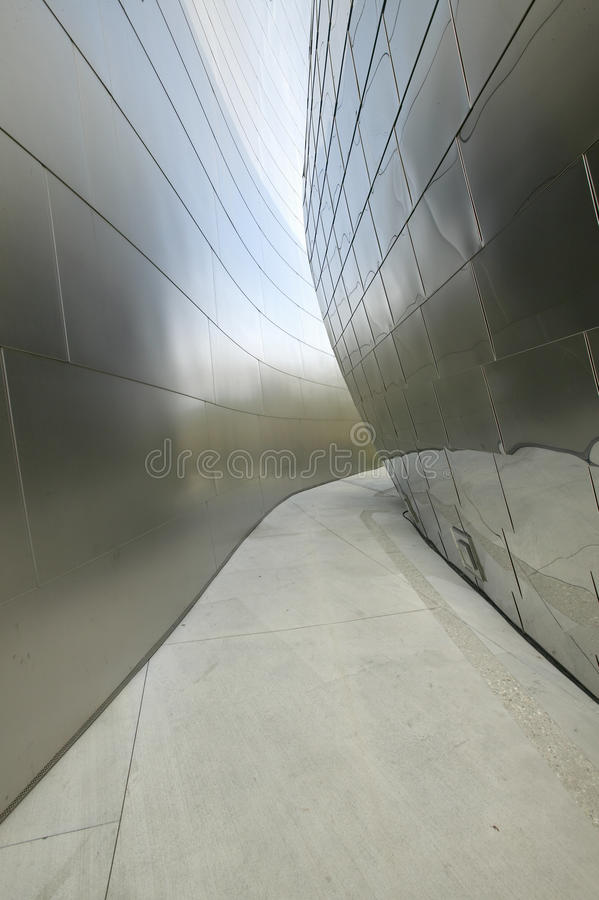 Walkway between stainless steel walls of Disney concert Hall, designed by Frank Gehry, in downtown Los Angeles, California stock images