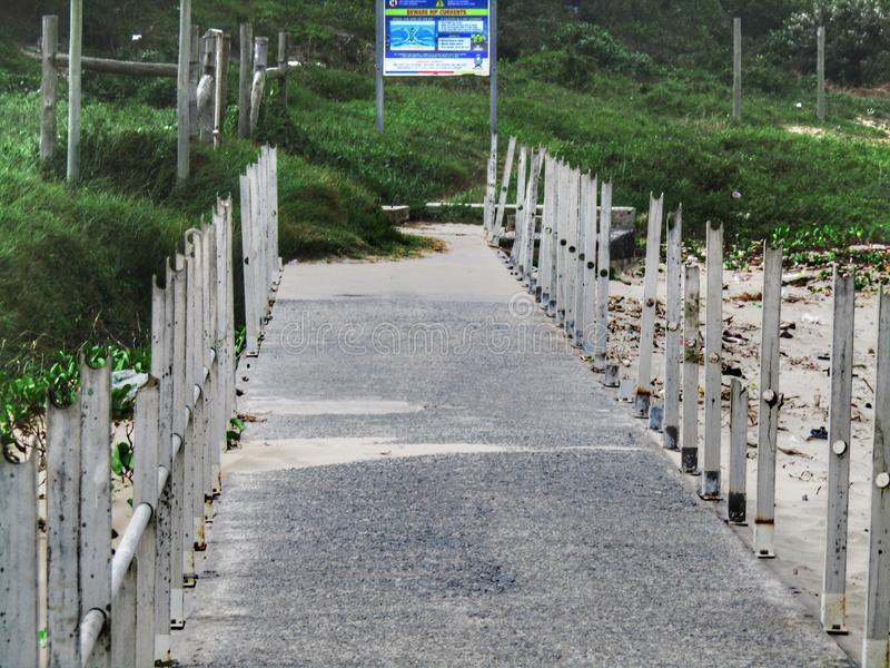 A walkway to the beach stock photography