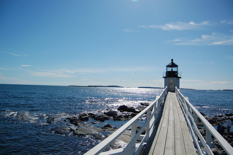 Walkway to lighthouse royalty free stock image