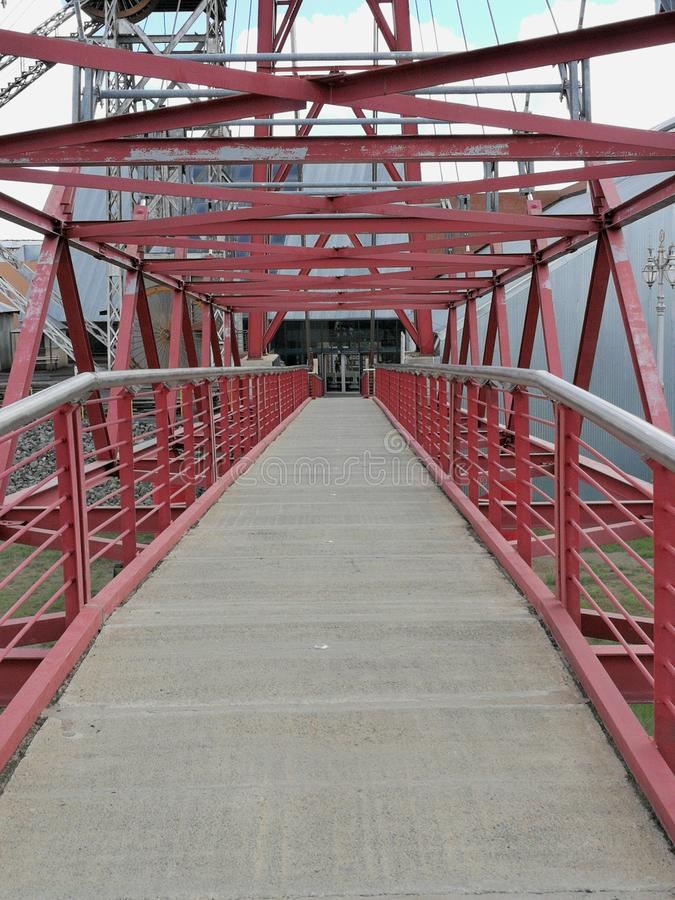 The walkway to the viewing platform at the Big Hole at Kimberly. The red metal walkway to the viewing platform at the Big Hole landmark at Kimberly in South stock image