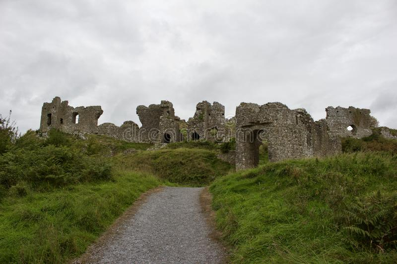 Pathway up to Medieval castle ruins in rural Ireland on an overcast day. Walkway up to a Medieval stone castle ruins in rural Ireland Rock of Dunamase an stock photo