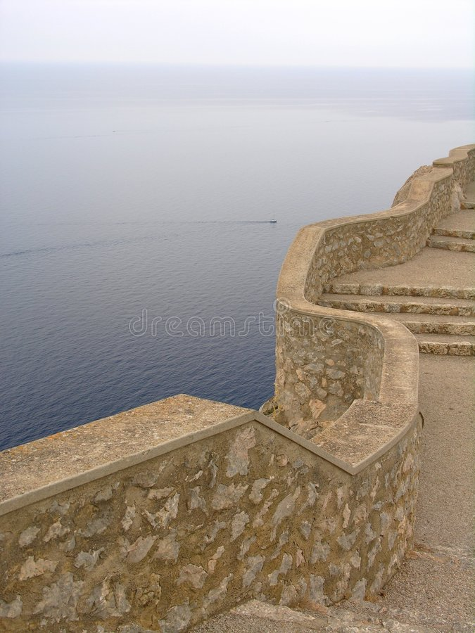 Wall above the ocean stock photography