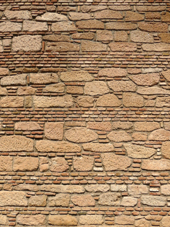 Wall of Alcazaba. Wall of bricks ands stones of the fortress of Alcazaba in the town of Malaga, Andalucia stock image