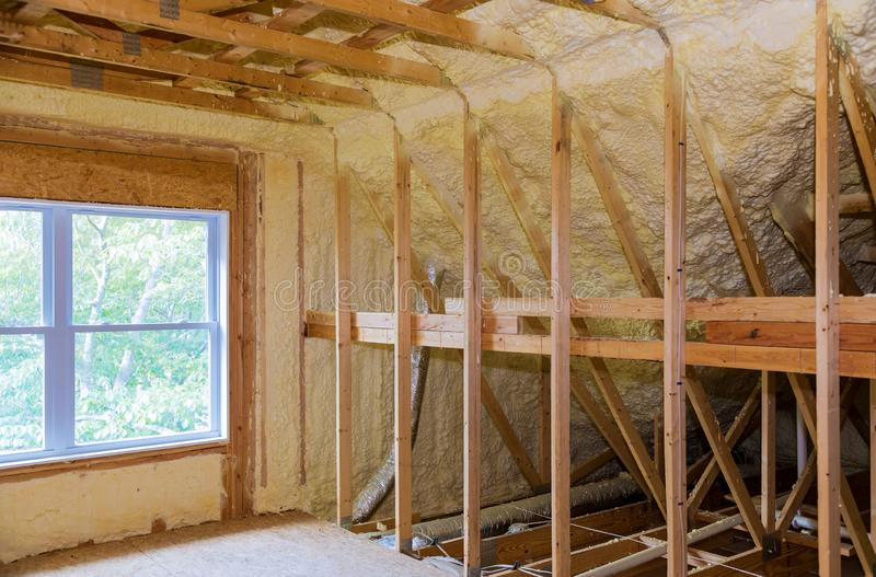 Wall of an apartment attic, covered with insulation foam before. Insulation insulation of a new building with foam attic of an apartment building, plastic, wall royalty free stock photo
