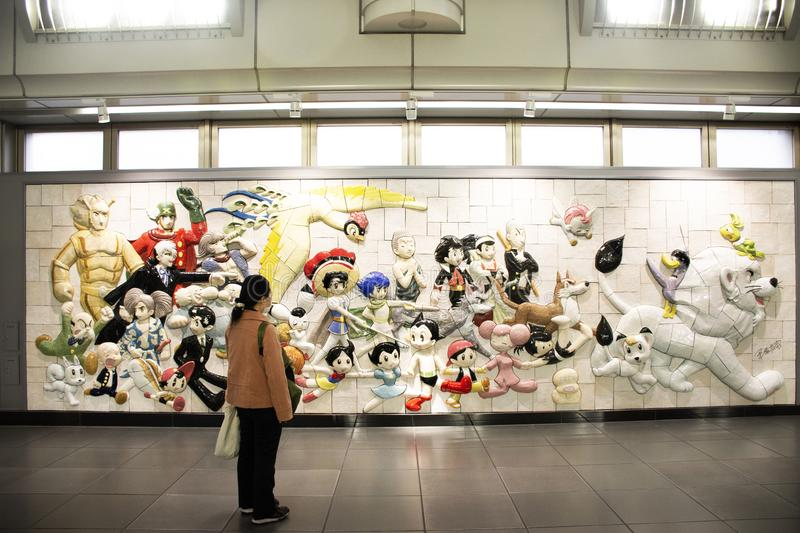 Wall art anime and hero japanese style in Ariake train JR railway Station at Koto in Tokyo, Japan stock photography