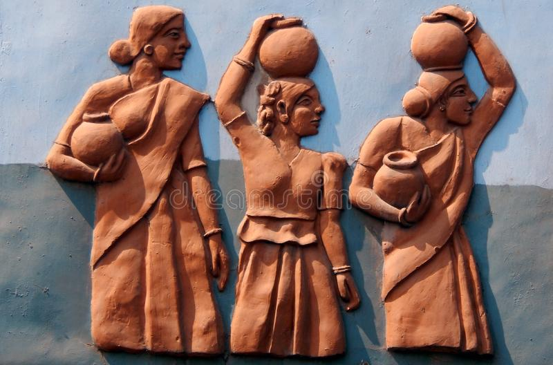 Wall art of Indian fetch water carrying in pots on heads royalty free stock photos