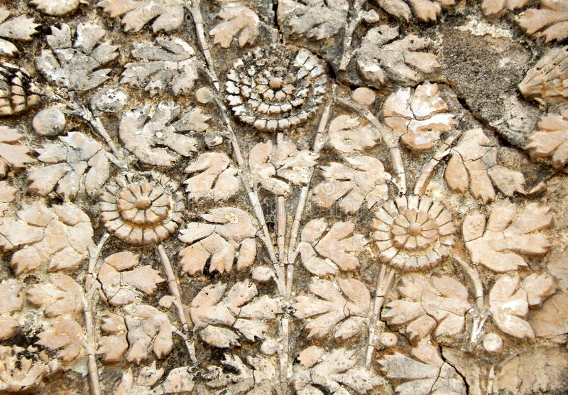 Wall art stucco work of fruits in basket designs on exteriors of 200 year old temple. Wall art stucco work of fruits in basket designs on exteriors of 200 year stock photos