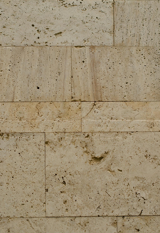 A wall from an artificial gray stone facade with rough fractured surfaces stock images