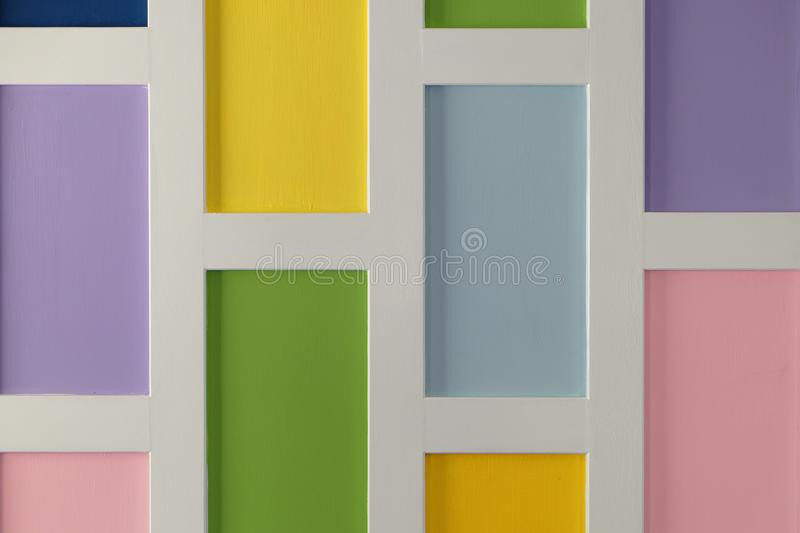 Wackground of multi square pastel colors with white frame stock image
