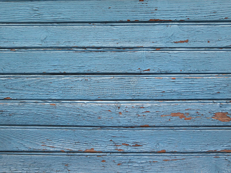 Wall background planks. Boards wall background. Blue paint patined by time and elements. Detail of a Creole house. Light and natural colors. Guadeloupe, French royalty free stock photos