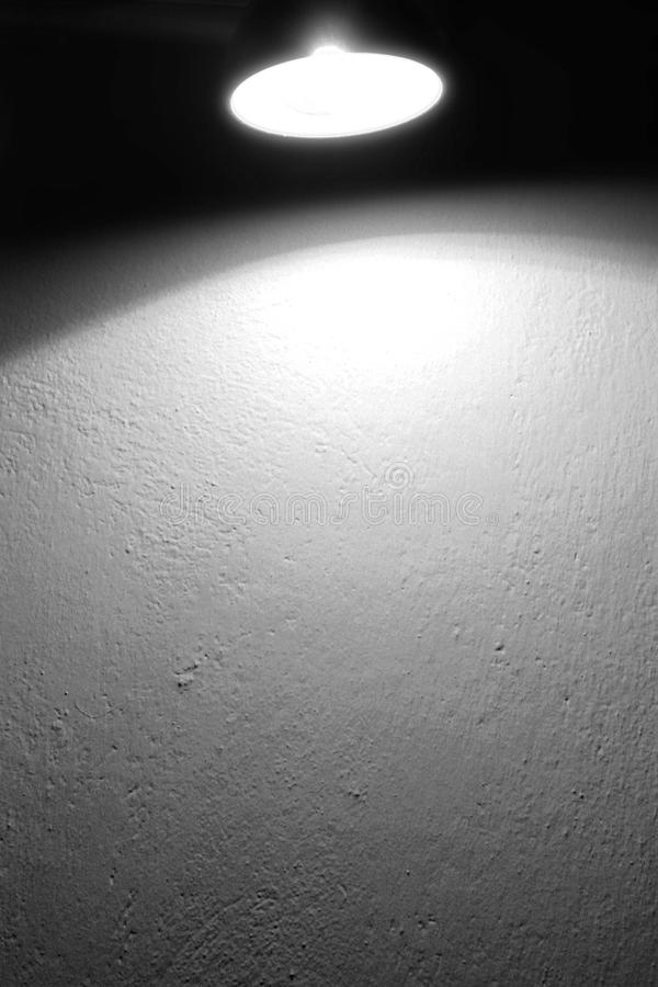 Wall background texture and spot light lamp and beam of light black and white background royalty free stock image