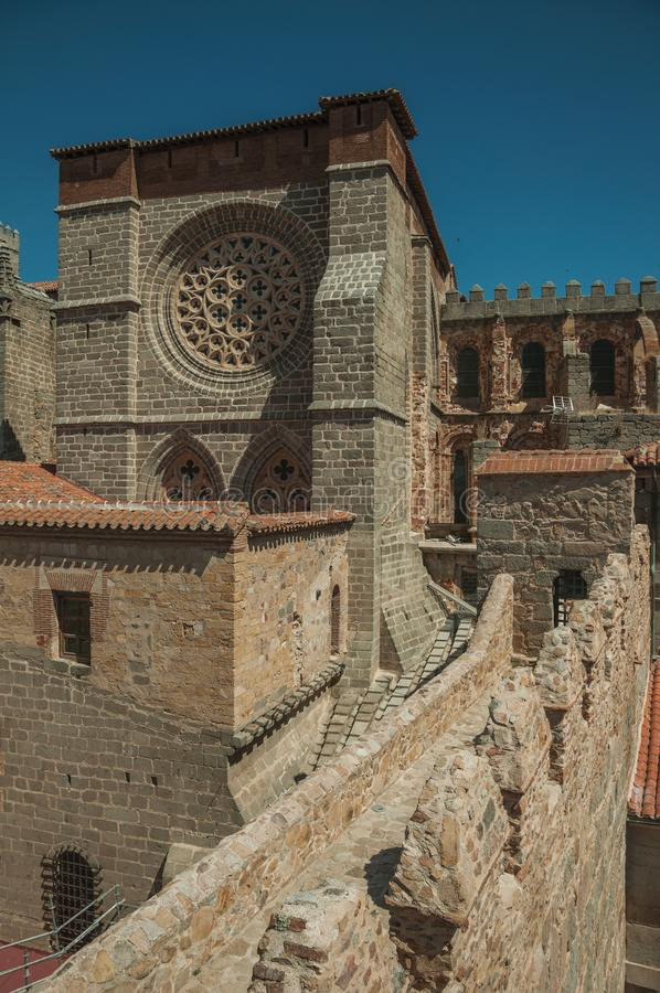 Wall with battlement and the Cathedral of Avila. Stone thick wall with battlement encircling the town and sidewall of the Cathedral of Avila. It has the longest stock images