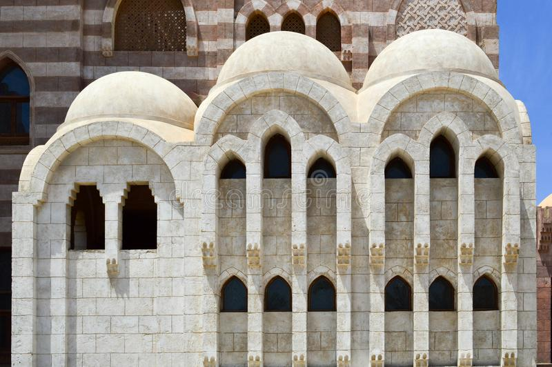 Wall with a beautiful texture of a Muslim Islamic Arab mosque made of white bricks is an architectural structure with arches, dome. A wall with a beautiful stock image