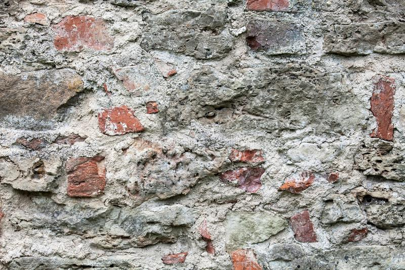 Wall of big stones and broken bricks stock photos