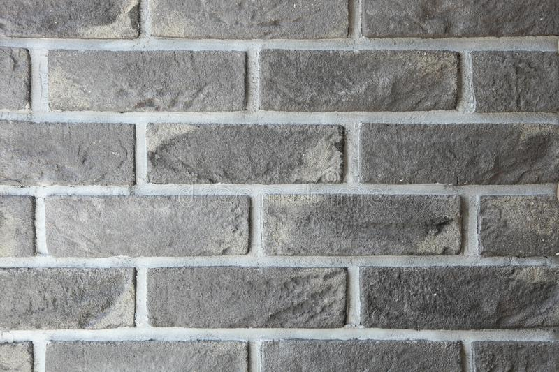 Wall with black brickwork. Stone texture, background. Copy space royalty free stock images