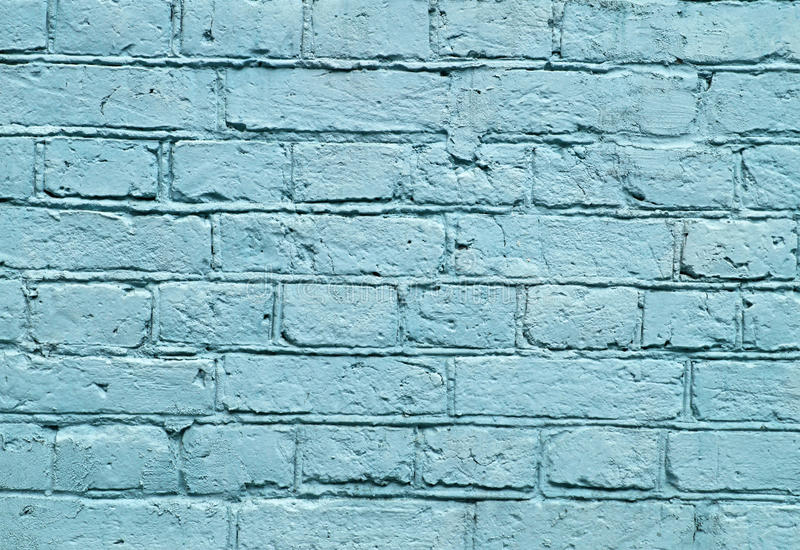 Wall with blue brick paint pattern paint stock photography