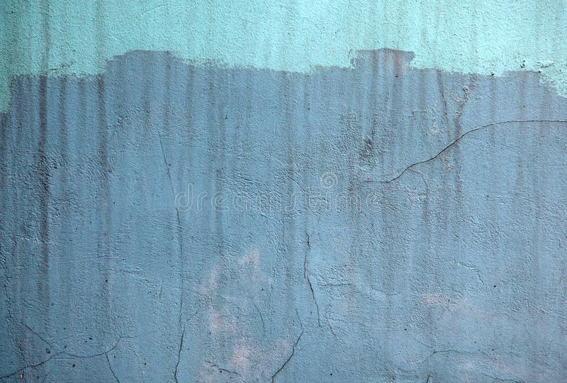 Wall with blue paint pattern paint stock photography