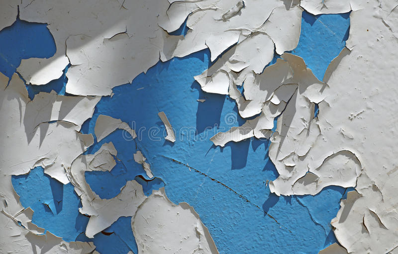 Wall with blue white peeling wall paint pattern paint royalty free stock image