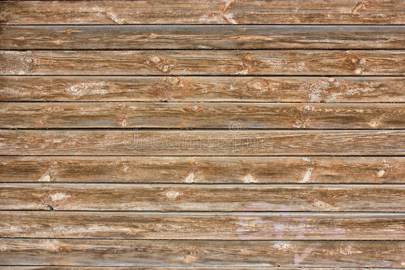 The wall of boards of an old building. Texture down time wood.  royalty free stock photos