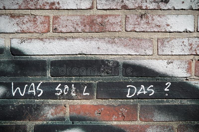 What should that?. Wall of brick with the inscription `what should that stock image