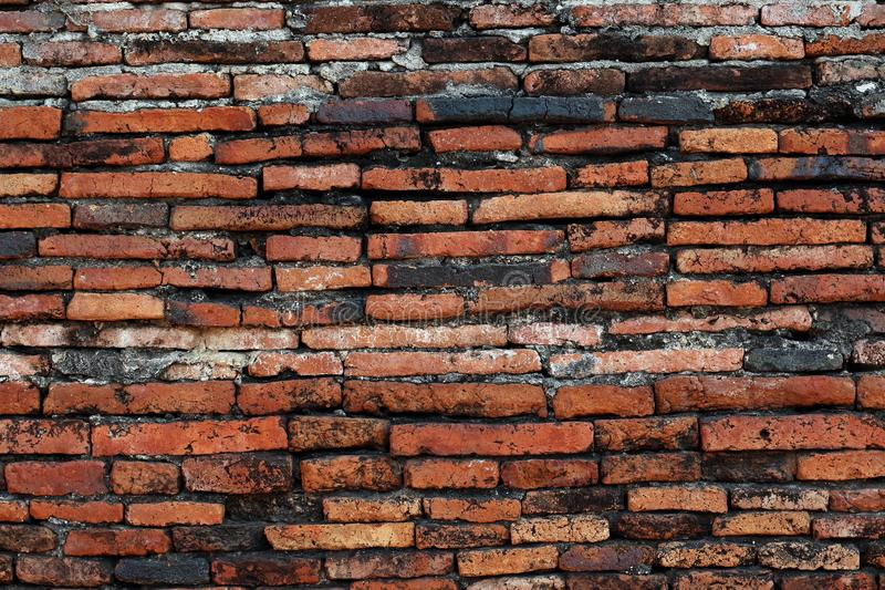 Wall brick old vintage background, Dirty brick texture with peeling plaster, wall brick texture of archaeological site stock photo