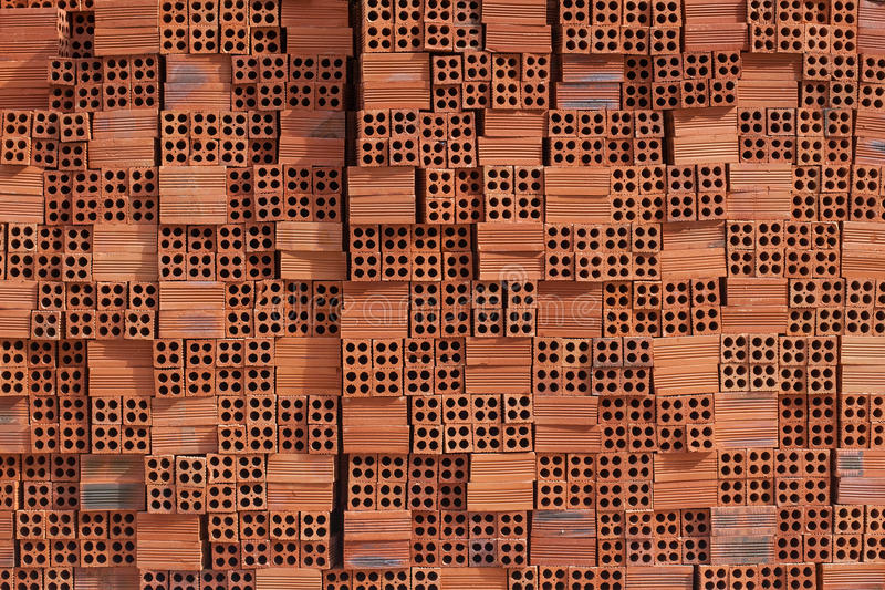 Wall of building collapsed uneven red brick. Textural background royalty free stock photography