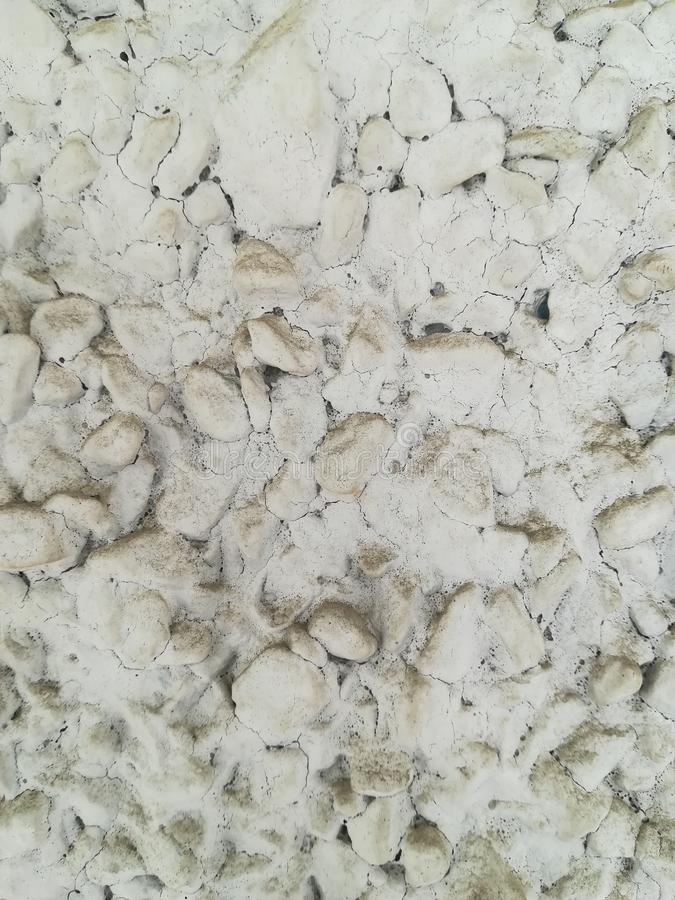 Concrete wall made of small stone. stock photo