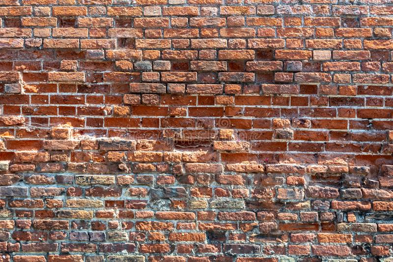 A wall built of different bricks stock photography