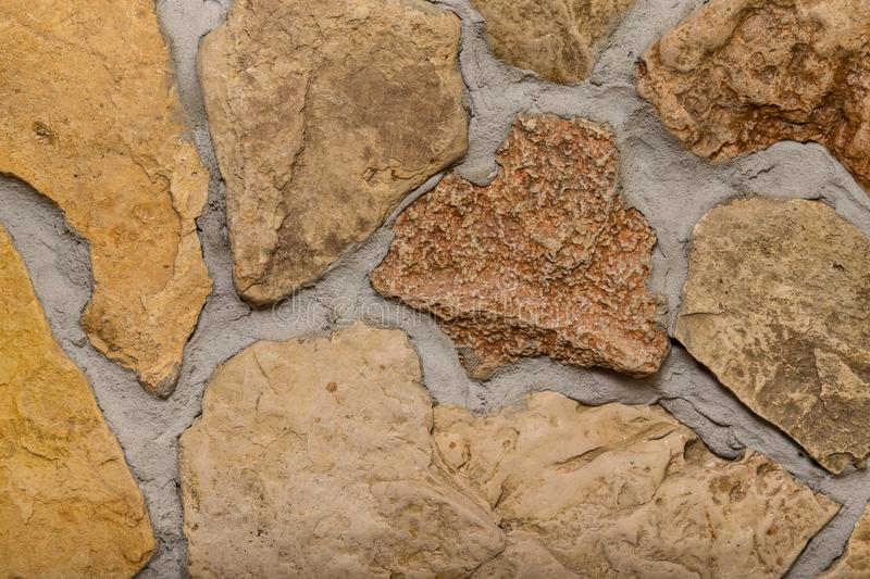 Wall built of natural stone with cement.  royalty free stock photo