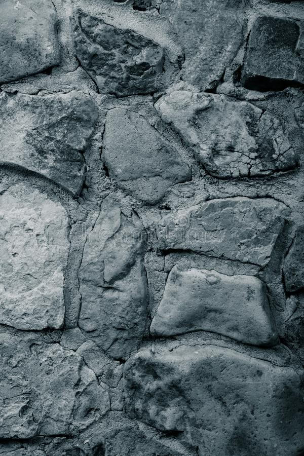 Wall built of natural stone with cement. Toned.  stock photo