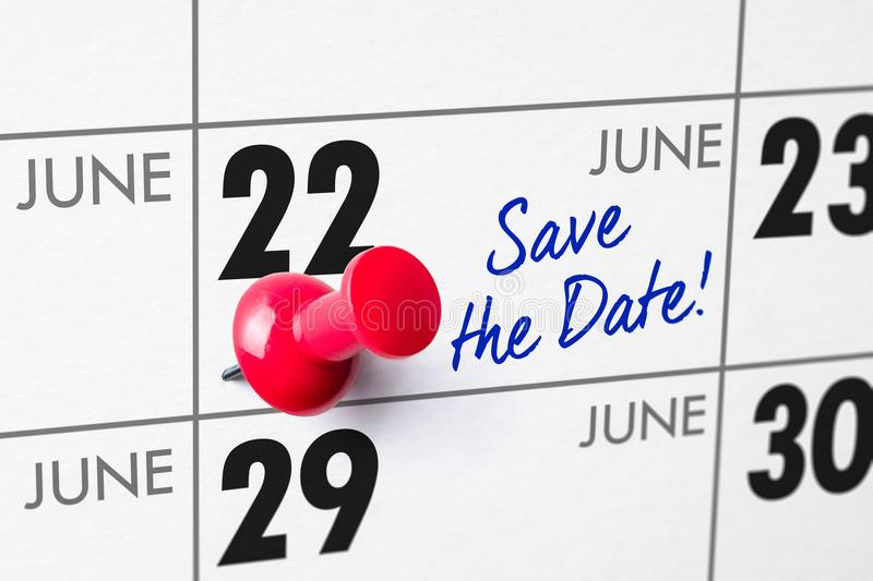 Wall calendar with a red pin - June 22 royalty free stock photo